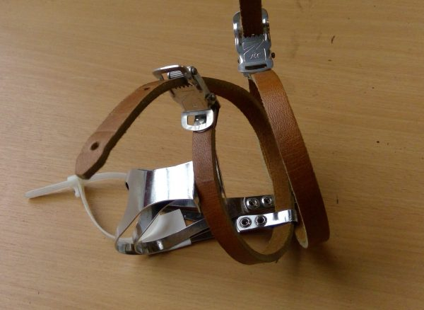 Pair of chrome toeclips with leather straps