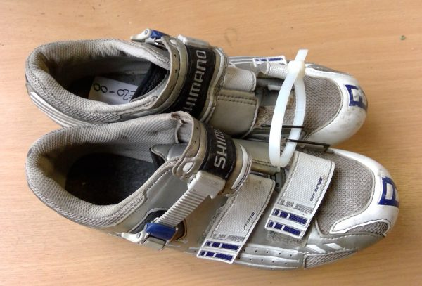 White and silver Shimano road cycling shoes